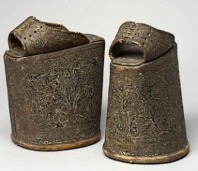 Spanish chopines before 1540 feature tooled leather over layered cork platforms.